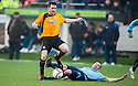 Alloa's Mark Docherty gets away from Forfar's Mark McCulloch.