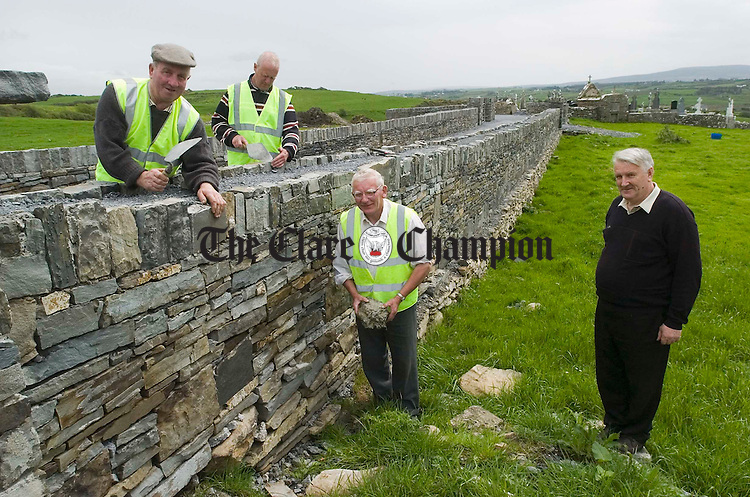 John Mc Carthy, John Frawley, Tom Barry and Maurice Harvey, supervisor putting the finishing touches to their work at Killeinagh cemetary. Photograph by John Kelly.