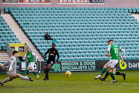 21st April 2021; Easter Road, Edinburgh, Scotland; Scottish Premiership Football, Hibernian versus Livingston; Kevin Nisbet of Hibernian shoots and scores the opening goal in the 8th minute