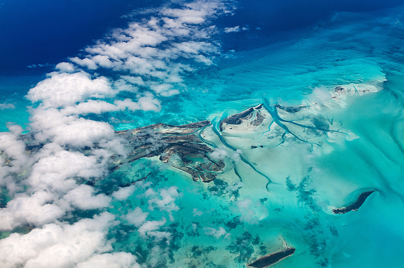 Aerial view of islands and clouds in the Bahamas.