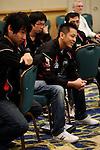The Chinese Tai Pei team wtaches their countries first match.