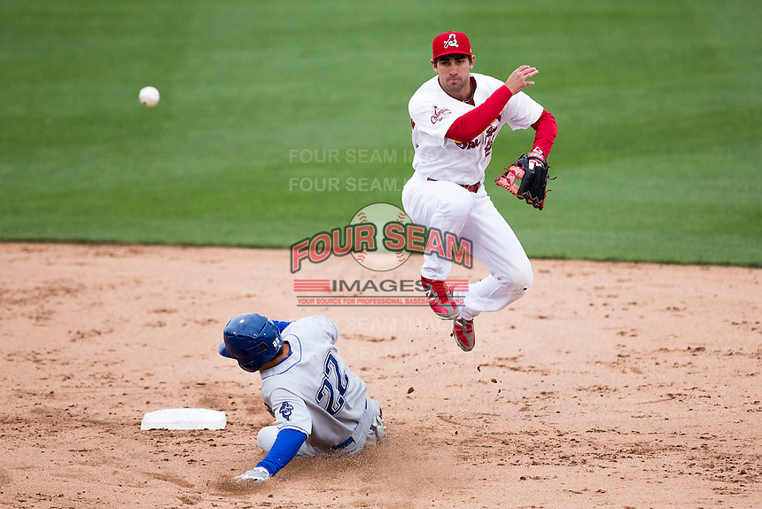 Jake Lemmerman #23 of the Springfield Cardinals leaps in the air while turning a double play during a game against the Tulsa Drillers at Hammons Field on May 4, 2013 in Springfield, Missouri. (David Welker/Four Seam Images)