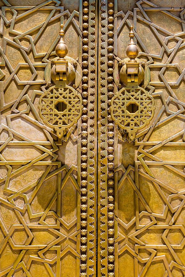 Fes, Morocco.  Door Knockers on Brass Door to the Dar El Makhsen, the King's Palace, Fes El Jedid.