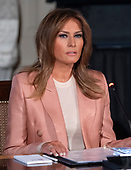 """First lady Melania Trump hosts a meeting of the Interagency Working Group on Youth Programs in the State Dining Room of the White House in Washington, DC on Monday, March 18, 2019.  The group was originally established under former United States President George W. Bush and is part of an effort to align the First Lady's """"Be Best"""" initiative with the working group. <br /> Credit: Ron Sachs / CNP"""
