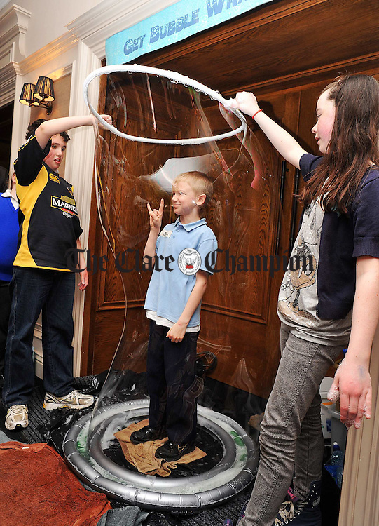 """Jake Cantwell getting """"Bubble Wrapped"""" at the School Science Fair in the Temple Gate hotel, as part of the Science Programme For Teachers recently run at Clare Education Centre. Photograph by John Kelly.."""