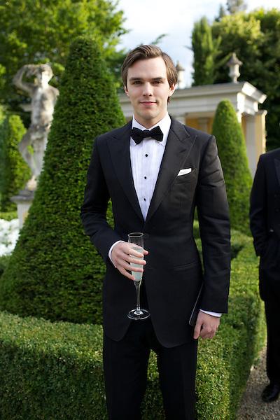 Nick Hoult wears Dolce & Gabbana black tie at Elton John's White Tie and Tiara Ball