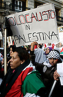 """Manifestazione nazionale a Roma, 17 gennaio 2009, di solidarieta' col popolo palestinese e contro i raid israeliani nella striscia di Gaza..A child holds a sign reading """"Holocaust in Palestine"""" during a national demonstration in Rome, 17 january 2009, in solidarity with Palestinians and against Israel's continued incursion into Gaza strip..UPDATE IMAGES PRESS/Riccardo De Luca"""