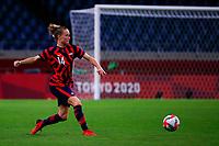 SAITAMA, JAPAN - JULY 24: Emily Sonnett #14 of the United States passes the ball during a game between New Zealand and USWNT at Saitama Stadium on July 24, 2021 in Saitama, Japan.