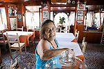 The patron of Peppino Restaurant in the township of Sant' Angelo in the southern end of Ischia island in the Tyrrhenian Sea, at the northern end of the Gulf of Naples.