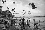 People in their daily chore at a ghat by river Ganga in Kolkata, India.