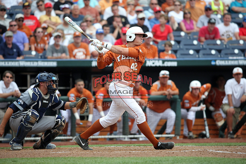 Kacy Clemens #42 of the Texas Longhorns bats during Game 1 of the 2014 Men's College World Series between the UC Irvine Anteaters and Texas Longhorns at TD Ameritrade Park on June 14, 2014 in Omaha, Nebraska. (Brace Hemmelgarn/Four Seam Images)