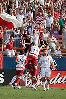 FC Dallas midfielder Eric Avilia (24) and defender Drew Moor (14) rush Kenny Cooper (33) to celebrate his second goal of the match. LA Galaxy vs FC Dallas at Pizza Hut Park Frisco, Texas July 27, 2008 Final Score 0-4.