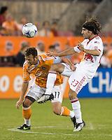 Houston Dynamo midfielder Brad Davis (11) is fouled by New York Red Bulls midfielder Juan Pietravallo (23).  Houston Dynamo tied New York Red Bulls 0-0 at Robertson Stadium in Houston, TX onApril 11, 2009.