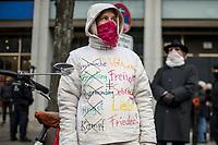 Ca. 70 Menschen protestierten am Mittwoch den 2. Dezember 2020 in Berlin vor Medienhaeusern gegen die ihrer Meinung nach, unausgewogene Berichterstattung ueber die Proteste von Coronaleugnern und forderten, dass sie und als Coronaleugner bekannte Aerzte als Experten in Talkshows eingeladen werden.<br /> Im Bild: Eine Demonstrantin mit einen Damenslip statt Mund-Nase-Schutz vor dem Gesicht hat sich auf ihre Jacke Parolen geschrieben.<br /> 2.12.2020, Berlin<br /> Copyright: Christian-Ditsch.de