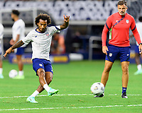 DALLAS, TX - JULY 25: Gianluca Busio #6 of the United States warming up before a game between Jamaica and USMNT at AT&T Stadium on July 25, 2021 in Dallas, Texas.