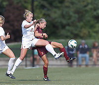 Virginia Tech midfielder Katie Yensen (3) attempts to control the ball as Boston College midfielder Jana Jeffrey (12) pressures.Virginia Tech (maroon) defeated Boston College (white), 1-0, at Newton Soccer Field, on September 22, 2013.