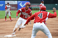 Batavia Muckdogs catcher Rodrigo Vigil (27) is congratulated by manager Angel Espada (4) after hitting a walk off two run home run in the bottom of the ninth inning during a game against the Williamsport Crosscutters on July 27, 2014 at Dwyer Stadium in Batavia, New York.  Batavia defeated Williamsport 6-5.  (Mike Janes/Four Seam Images)