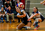 Perryville's Marissa Phillips and Kayla Toem try to dig a ball during the Perryville High School versus Dunbar High School match in the Semifinals of the Maryland State Volleyball 1A Championship at Ritchie Coliseum in College Park, Maryland on November 12, 2012. Perryville defeated Dunbar 25-21, 25-7 and 25-22 in straights sets to earn a rematch with Smithsburg for the State 1A Title.