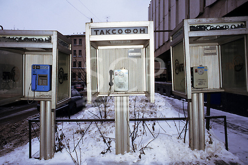 Russia. Three telephone booths with snow on the ground.