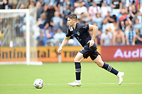 KANSAS CITY, KS - JUNE 26: Andreu Fontas #3 Sporting KC with the ball during a game between Los Angeles FC and Sporting Kansas City at Children's Mercy Park on June 26, 2021 in Kansas City, Kansas.
