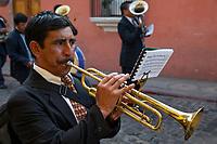 Antigua, Guatemala.  Trumpet Player in a marching band, Semana Santa.