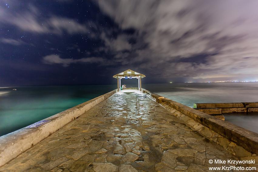"Waikiki stone pier (aka ""Kapahulu Groin"") at night"