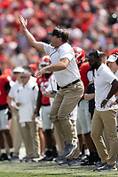 ATHENS, GA - OCTOBER 2: Kirby Smart shouts instruction to his team during a game between Arkansas Razorbacks and Georgia Bulldogs at Sanford Stadium on October 2, 2021 in Athens, Georgia.