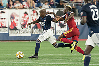 FOXBOROUGH, MA - SEPTEMBER 21: Sam Johnson #50 of Real Salt Lake tackles Luis Caicedo #27 of New England Revolution during a game between Real Salt Lake and New England Revolution at Gillette Stadium on September 21, 2019 in Foxborough, Massachusetts.