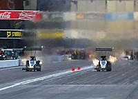 Feb 9, 2019; Pomona, CA, USA; NHRA top fuel driver Mike Salinas (right) races alongside Scott Palmer during qualifying for the Winternationals at Auto Club Raceway at Pomona. Mandatory Credit: Mark J. Rebilas-USA TODAY Sports