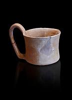 Hittite terra cotta big handled tankard mug. Hittite Empire, Alaca Hoyuk, 1450 - 1200 BC. Alaca Hoyuk. Çorum Archaeological Museum, Corum, Turkey. Against a black bacground.