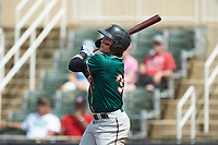 Mason Martin (35) of the Greensboro Grasshoppers follows through on his swing against the Piedmont Boll Weevils at Kannapolis Intimidators Stadium on June 16, 2019 in Kannapolis, North Carolina. The Grasshoppers defeated the Boll Weevils 5-2. (Brian Westerholt/Four Seam Images)
