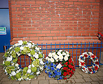 Wreaths and floral tributes from Celtic, Rangers and the supporters at the base of the Ibrox memorial statue