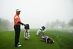 JEJU, SOUTH KOREA - APRIL 22: Mardan Mamat of Singapore waits to tee off on the 4th hole while the fog delay the Round the Round One of the Ballantine's Championship at Pinx Golf Club on April 22, 2010 in Jeju island, South Korea. Photo by Victor Fraile / The Power of Sport Images