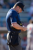 Home plate umpire Matt Abbott checks the lineup cards prior to the start of the Carolina League game between the Salem Avalanche and the Winston-Salem Warthogs at Ernie Shore Field in Winston-Salem, NC, Saturday, May 10, 2008.