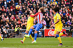 Atletico de Madrid Antoine Griezmann and UD Las Palmas Pedro Bigas and Pablo Mauricio Lemos during La Liga match between Atletico de Madrid and UD Las Palmas at Vicente Calderon Stadium in Madrid, Spain. December 17, 2016. (ALTERPHOTOS/BorjaB.Hojas)