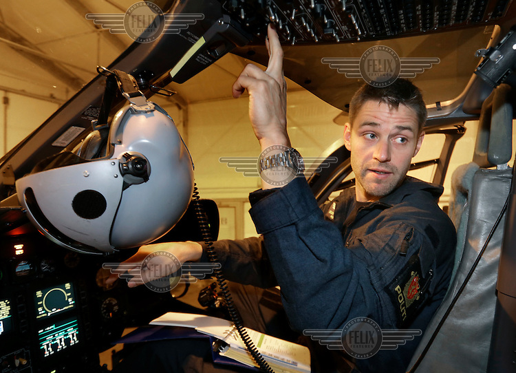 Norwegian Police Helicopter pilot Stian Ødegaard performing system check prior to a mission.