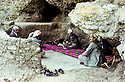 Iraq 1982 .In a cave in Kalashin, Masoud Barzani , Mulazem Ali and left, Abdulla Kado Libari ( he will be killed later by PKK ).Irak 1982.Dans une grotte de Kalashin, region de Candil, Masoud Barzani avec Mulazem Ali et a gauche Abdulla Kado Libari ( il sera tue plus tard par le PKK )