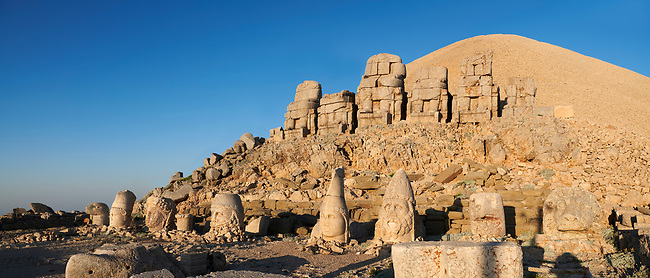Statue heads with headless seated statues in front of the stone pyramid 62 BC Royal Tomb of King Antiochus I Theos of Commagene, east Terrace, Mount Nemrut or Nemrud Dagi summit, near Adıyaman, Turkey