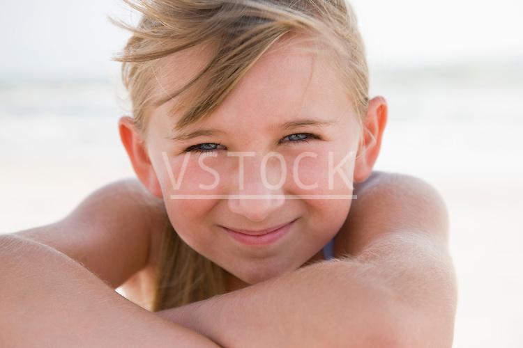 USA, Florida, St. Pete Beach, Portrait of smiling girl (8-9) on beach