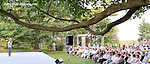 During a break in the performance of his company Pontus Lidberg speaks to the audience in the outdoor garden at the Rockefeller Brothers Funds' Pocantico Center, August 8, 2014