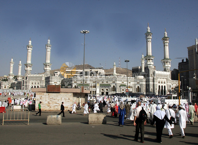 Muslim pilgrims walk outside the Grand Mosque during the annual Hajj in Mecca, Saudi Arabia, Nov 7, 2010. Some 2.5 million Muslims from more than 160 countries converge annually on the Islamic cities of Mecca and Medina in western Saudi Arabia for the hajj pilgrimage. Photo by Mahfouz Abu Turk