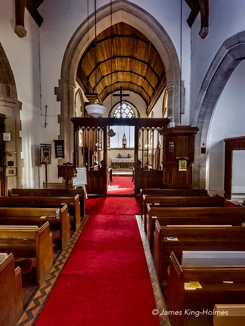 The nave of the Parish Church of St. Nicholas in Fyfield, Oxfordshire, UK. The church was rebuilt after being almost destroyed by fire in 1893.