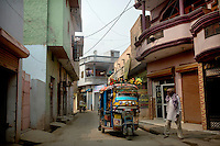A small rickshaw taxi on a street in Panipat.