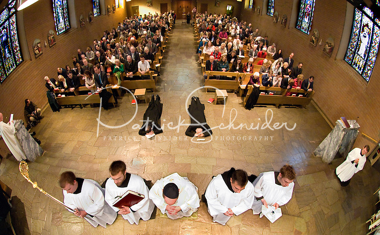 Two Belmont Abbey Monks lay prostrate during a commitment ceremony The Rite of Solemn Profession at Belmont Abbey in Belmont, NC.