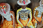 Body painted Pulikali performers wait before performance during annual Pulikali festival on 3rd Onam day at Trichur, Kerala, India..Pulikali or Kaduvvakali is a two hundred year old folk dance form, practised mostly in Thrissur and Palghat districts of Kerala. It liberally makes use of forms and symbols of nature that finds expression in its bright, bold body painting and high-energy dance movements. The philosophy of Pulikali is that human and nature are integral parts of each other. So by fusing man and beast in its artistic language, it flamboyantly celebrates the connection. Arindam Mukherjee