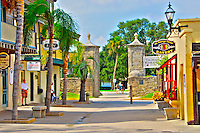 A beautiful sunny day on St. George Street in downtown St. Augustine, Florida. The City Gates mark the entrance to the pedestrian only street.