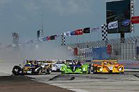 4-5 April 2008, St Petersburg, Florida, USA.Scott Sharp (center), Acura ARX-01B, puts a fender to Maassen in the Porsche #6 in the first turn..©2008 F.Peirce Williams, USA .