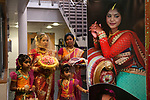 Hindu Coming of Age celebration party London Uk The display photograph is of the young woman. She is on the left wearing a veil, with her mother and young relatives. She is 16yrs old. Mitcham south London Uk They  are welcoming guests to the very big Ritusuddhi, also called as Ritu Kala Samskara party.