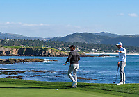 9th February 2020, Pebble Beach, Carmel, California, USA; Steve Young and Nick Taylor check out the cup on the 18th green at the championship round of the AT&T Pro-Am on Sunday