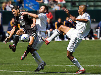 DC United's Christian Gomez is taken down in the box by LA's Dema Kovalenko (l) and Tony Sanneh (r).  The LA Galaxy and DC United play to 2-2 draw at Home Depot Center stadium in Carson, California on Sunday March 22, 2009.